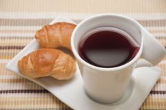 Tea and mini croissants. On a white plate Stock Photography