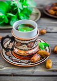 Tea with mint in arab style  on wooden table. Royalty Free Stock Images