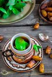 Tea with mint in arab style  on wooden table. Stock Photo
