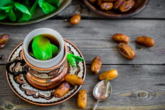 Tea with mint in arab style  on wooden table. Stock Image