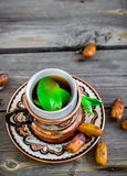 Tea with mint in arab style  on wooden table. Royalty Free Stock Photo