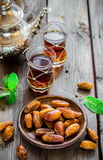 Tea with mint in arab style  on wooden table. Royalty Free Stock Photography
