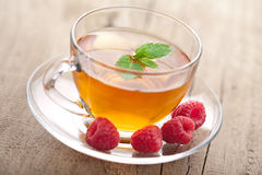 Tea with mint and berry Royalty Free Stock Images