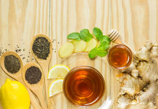 The tea with mint honey ginger and lemon on wood background,warm ton Stock Images