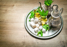 Tea with mint leaves and arabic delight. Oriental hospitality Stock Photos
