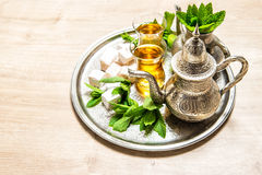Tea with mint leaves and traditional turkish delight. Holidays t Stock Photos