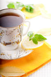 Tea with mint and lemon. Black tea and fresh green mint Stock Photography
