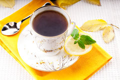 Tea with mint and lemon. Black tea and fresh green mint horizontal Stock Photo