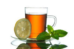 Tea , mint and lemon. Cup of tea with mint and lemon Royalty Free Stock Photo