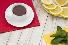 Tea with mint. And lemon on a light table Stock Photos