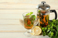 Tea with mint and lemon. On wooden backround. National medicine Royalty Free Stock Photography