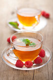 Tea with mint and raspberry Stock Image