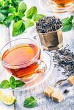Tea. Mint Tea. Herbal tea. Mint leaf. Mint leaves. Tea in a glass cup, mint leaves, dried tea, sliced lime. herbs tea and mint lea Royalty Free Stock Image