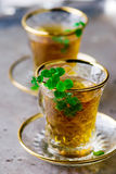 Tea with mint in traditional Turkish glass cup Royalty Free Stock Photos