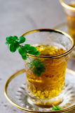 Tea with mint in traditional Turkish glass cup Stock Image