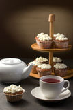 Tea with muffins Stock Photos