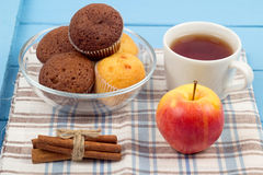 Tea, muffins, apples and cinnamon. On a napkin Royalty Free Stock Images