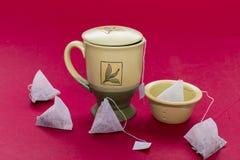 Tea mug and bags Royalty Free Stock Images