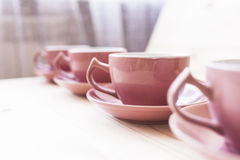 4 tea mugs on wood table Stock Photography