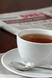 Tea and newspaper Royalty Free Stock Image