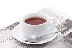 Tea and newspaper Stock Photography