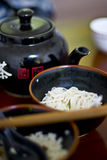 Tea and noodles. Chinese tea pot and bowls with noodles Royalty Free Stock Photo