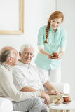 Tea at nursing home. Two older men drinking tea in common room at nursing home stock photography