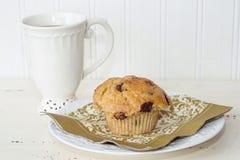 Tea och en muffin Arkivfoto