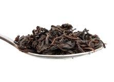 Tea och sked Arkivfoton