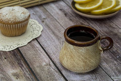 Tea in the old circle. Tea in the old mug on a wooden table Royalty Free Stock Photos