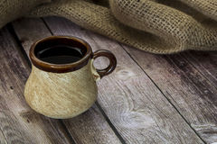 Tea in the old circle. Tea in the old mug on a wooden table Royalty Free Stock Photo