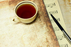 Tea and old paper. Cup of tea and old paper royalty free stock photos