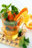 Tea with orange and branches of mint Stock Image