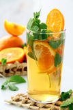 Tea with orange and branches of mint Stock Photography