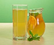 Tea, orange drink and spearmint Stock Images