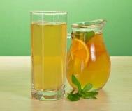 Tea, orange drink and spearmint Stock Images