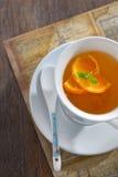 Tea with orange slices Stock Images