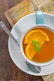 Tea and orange slices Stock Photo