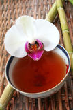 Tea and Orchid stock photo