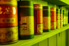 Tea packaging stand in a row on the shelf.  Royalty Free Stock Image