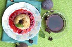 Tea, pancakes with bilberry jam Stock Photography