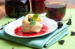 Tea, pancakes with bilberry jam Royalty Free Stock Photo