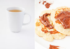 Tea and pancakes with chocolate Royalty Free Stock Images