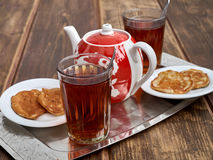 Tea pancakes. Glassful teapot tea pancakes in Russian style Stock Photos
