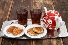 Tea pancakes. Glassful teapot tea pancakes in Russian style Stock Photography