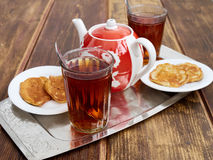 Tea pancakes. Glassful teapot tea pancakes in Russian style Royalty Free Stock Photography