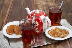 Tea pancakes. Glassful teapot tea pancakes in Russian style Royalty Free Stock Photos