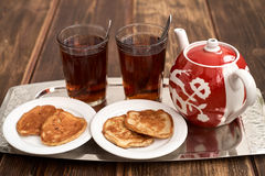 Tea pancakes. Glassful teapot tea pancakes in Russian style Stock Images