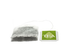 Tea paper sachet with green label Stock Images