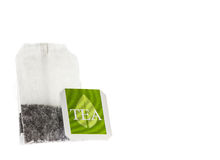 Tea paper sachet with green label Stock Image